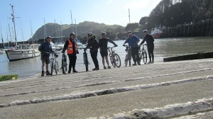 Dipping bikes in the sea at the start of the Devon C2C at Ilfracombe